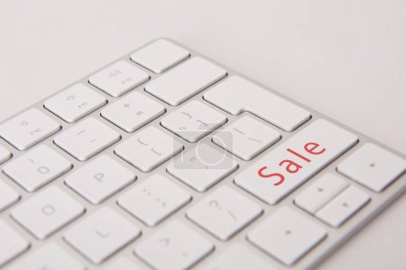 close-up shot of computer keyboard with black friday button isolated on white