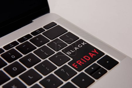 close-up shot of laptop keyboard with black friday button isolated on white