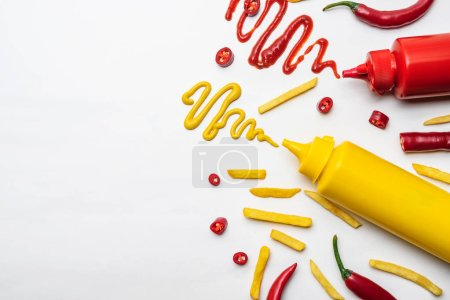 top view of french fries with mustard and ketchup on white surface