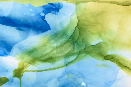 beautiful green and blue splashes of alcohol inks as abstract backdrop