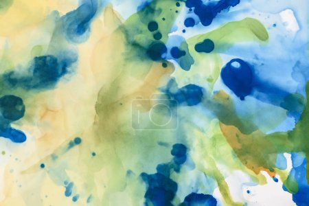 yellow, green and blue splashes of alcohol inks as abstract background