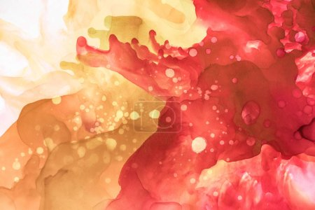 beige and red splashes of alcohol inks as abstract background