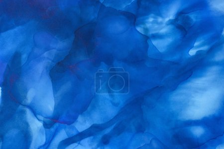 dark blue splashes of alcohol ink as abstract background
