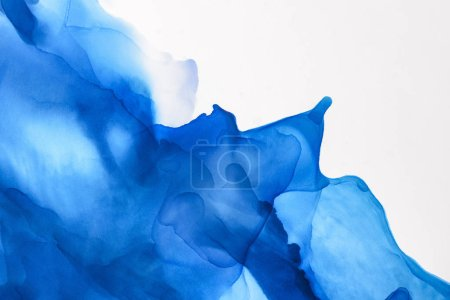 Photo for Blue splashes of alcohol ink on white as abstract background - Royalty Free Image