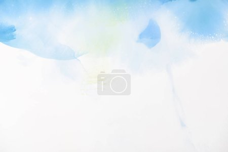 Photo for Light blue and green splashes of alcohol inks on white as abstract background - Royalty Free Image