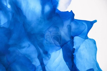 beautiful blue splashes of alcohol ink as abstract background