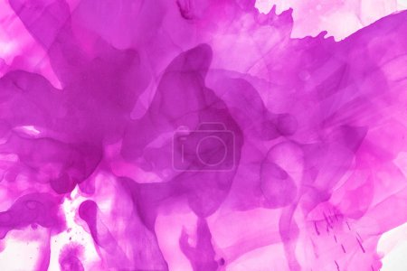 violet splashes of alcohol ink as abstract background