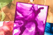 brown, purple and red splashes of alcohol inks as abstract background