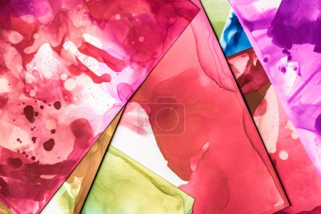 Photo for Beautiful red and purple splashes of alcohol inks on paper sheets as abstract background - Royalty Free Image