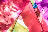 beautiful red and purple splashes of alcohol inks on paper sheets as abstract background