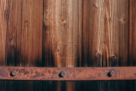close-up shot of wooden planks and rusty metal framing for background