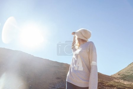 bottom view of woman looking at mountain under sunlight, Carpathians, Ukraine