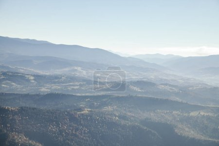 Photo for Hazy mountains landscape under blue sky, Carpathians, Ukraine - Royalty Free Image