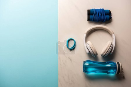 Photo for Top view of arranged set of gym equipment on blue and marble - Royalty Free Image