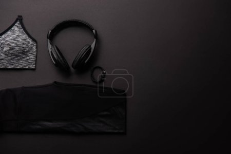 Photo for Elevated view of arranged composition with gym equipment isolated on black, minimalistic concept - Royalty Free Image