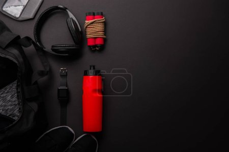 Photo for Elevated view of arranged composition with gym equipment isolated on black - Royalty Free Image