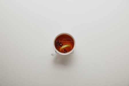 top view of cup of hot tea on white background