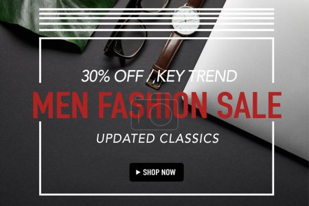 Photo for Laptop with glasses and watch on black background with green leaf, men fashion sale inscription - Royalty Free Image