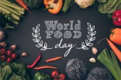 top view of ripe vegetables on gray table, world food day
