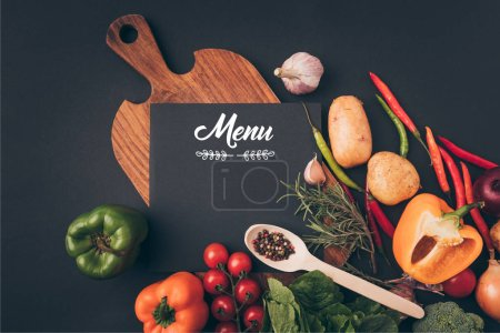 Photo for Top view of black board with menu lettering on wooden table with vegetables on gray table - Royalty Free Image