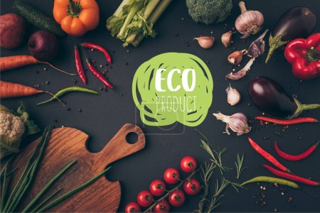 top view of different vegetables and cutting board on table with eco product lettering
