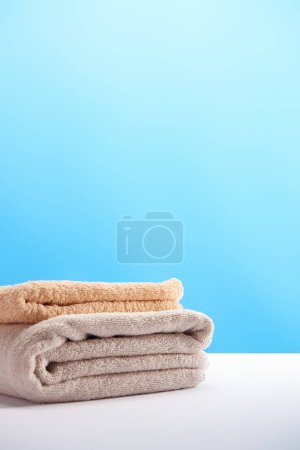 Photo for Stack of clean fresh soft towels on white table - Royalty Free Image