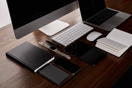 Photo for Modern workplace with various gadgets on wooden table - Royalty Free Image