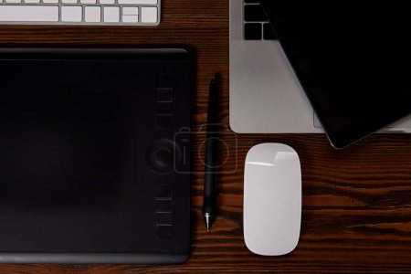 Photo for Top view of graphics designer workplace on wooden table - Royalty Free Image