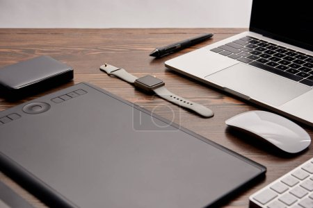 Photo for Close-up shot of cg artist gadgets on wooden table - Royalty Free Image