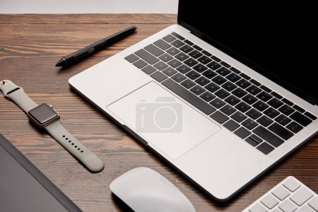 Photo for Close-up shot of graphic designer gadgets on wooden table - Royalty Free Image