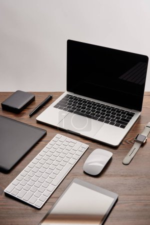 Photo for Laptop with other various gadgets on graphics designer workplace - Royalty Free Image