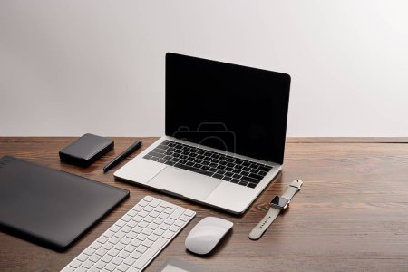 Photo for Laptop with other different gadgets on graphics designer workplace - Royalty Free Image
