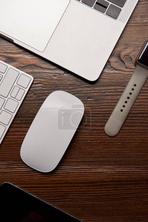 top view of various wireless devices on wooden table