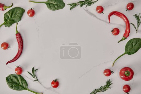 flat lay frame with fresh vegetables and herbs on white background