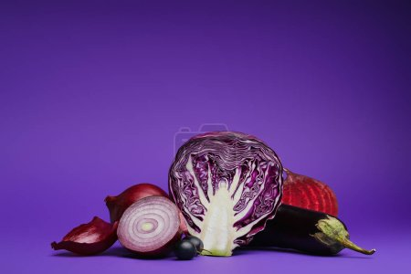 sliced cabbage, onions, grapes, beetroot and eggplant on purple