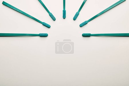 Photo for Flat lay with arrangement of toothbrushes on white background - Royalty Free Image