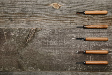 Top view of five carpentry files tools on wooden background