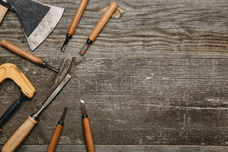 Photo for Top view of various carpentry tools on wooden background - Royalty Free Image