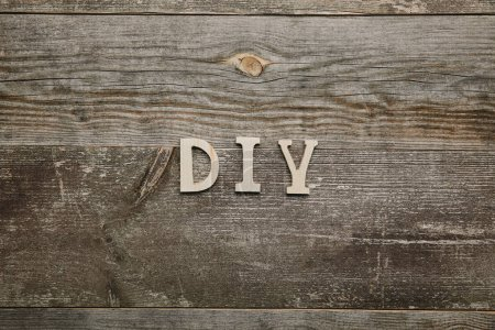 Top view of wooden diy sign on wooden background
