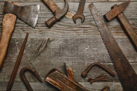Top view of various tools on wooden background