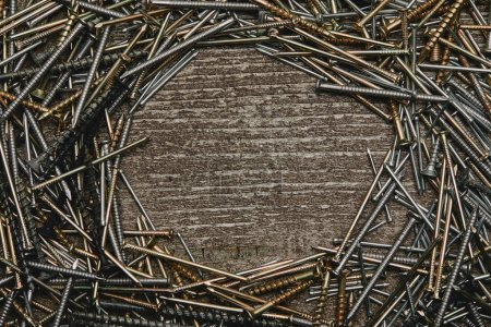 Top view of nails arranged on wooden table