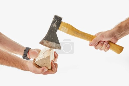 Partial view of men cutting log by axe isolated on white