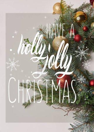 """Foto de Superior vista de corona de abeto de Navidad con adornos rojos y dorados, aislados en blanco con """"tienen un holly jolly christmas"""" inspiración y copos de nieve - Imagen libre de derechos"""
