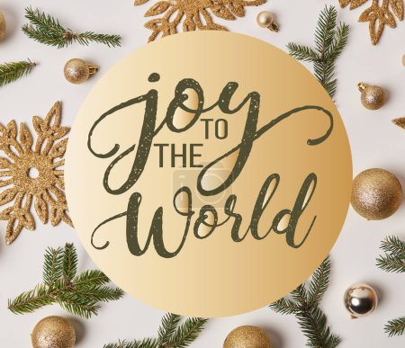 "Photo for Top view of golden Christmas decoration on white with ""joy to the world"" inspiration - Royalty Free Image"