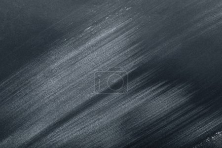 full frame image of black table with flour strokes