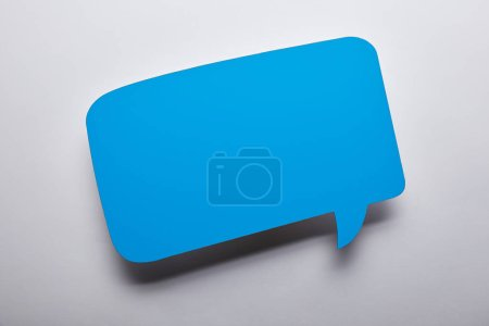 Photo for Top view of empty blue speech bubble on grey background - Royalty Free Image
