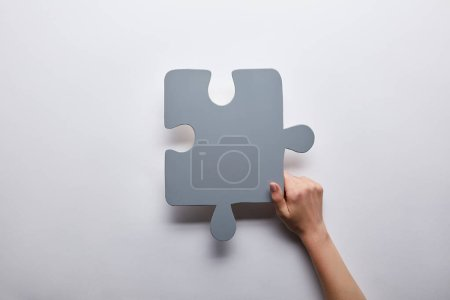 top view of grey puzzle problem solution symbol on grey background