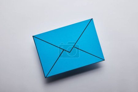 top view of blue email sign on grey background
