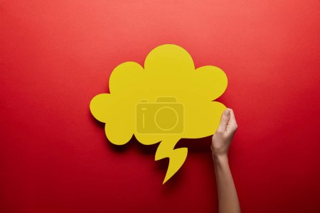 Photo for Top view of empty yellow thought bubble on red background - Royalty Free Image