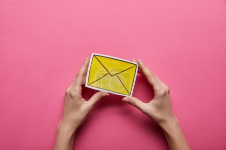Photo for Top view of yellow email sign on pink background - Royalty Free Image